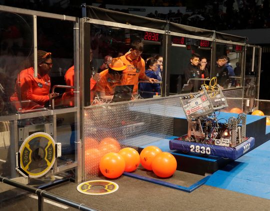Operators Mikalayah Tulloch, Arianna Massey, Damien Berna and Mordechai Tinney guide their 2830 robot.